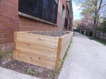 The beds are made out of cedar and cost approximately $250 each including labor and materials.