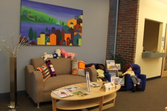 Welcome lobby has furniture that's inviting for both children and adults